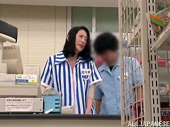 Kinky Japanese woman gets her pussy fingered and toyed right in a supermarket by her colleague. After that she gives him a blowjob and then she gets fucked from behind.