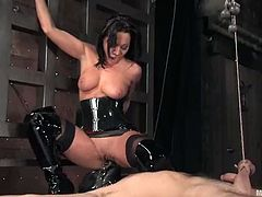 Kinky Sandra Romain is a mistress in latex dress. She stuffs tied up guy in his ass. Then she sucks and rides his dick.