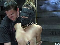 Some guy tied this girl up and then fixes clothespins and pumps to her tits. After that she gets tied up and toyed.