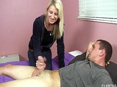 Clothed blonde is giving a hot handjob in HD