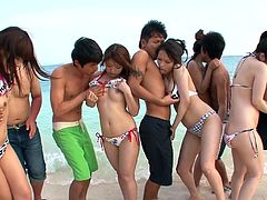 These cute Japanese girls are frolicking on the beach and their men and running around slapping their nice round asses. The couples make out and the girls lick each other's nipples. The sexy ladies put their knees in the sand and suck juicy dick.