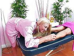 Massage table fun with two hot blondes