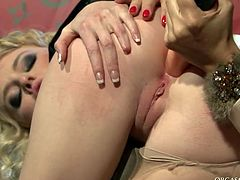 Playful blond whore enjoys getting her shaved cunt tickled