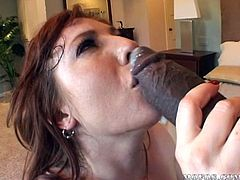 Feeling huge black cock pounding her juicy cunt makes her moan and undulate like a slut