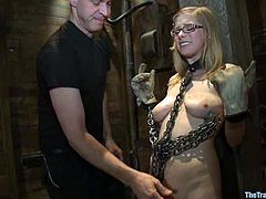 Tied up blonde chick gets chained and whipped. Later on she gets her tight ass drilled. After that she gives hot blowjob to a guy in mask.