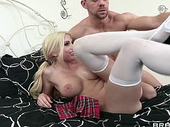 This blonde bimbo gets down on her knees to suck her man's pecker then lets him stick his cock in her wet tits, too. She lets his cock fly into her mouth upon each hard thrust between her melons. She enjoys a good banging afterwards.
