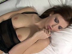 Get a load of this hottie's wet pussy and soft natural breasts in this solo scene where she fingers away while the camera films her.