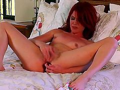 Elle Alexandra with small tities and bald beaver does her best to give herself as much pleasure as she can