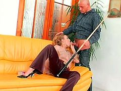 Torrid blondie in heels and tight pants sits on the couch. She gets disturb from reading, cuz slut sees a bald headed stud next to her. Horny gal stretches legs wide to get her wet pussy rubbed with a cue. And then whore turns over for giving a blowjob right away.