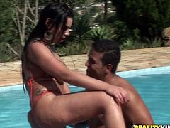 Well stacked Latin hot pants swims in a pool with a sex greedy dude wearing tiny bikini before they get out where he oral strokes her oversized baggy tits and kisses juicy cellulite ass.
