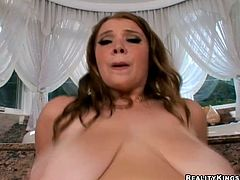 She is voluptuous bitch with giant natural tits. She is poked from behind intensively. Then she tops the rod riding on it actively.