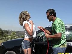 Divine chocolate babe and insatiable fucker start spraying each other with water during a car wash. Later he takes off her white shirt in order to rub cuddly perky tits with pleasure.