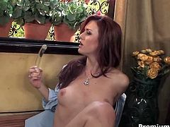 Mind taking red-haired babe sits on a window sill petting her perky round tits and teasing her cunt with finger before she takes a dildo to pound her shaved cunt rapaciously.