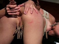 Lovely blonde girl gets tied up and gagged by lovely brunette. Later on Gia fixes clothesins to blonde's pussy lips. In addtion Sasha gets fucked with a strap-on.