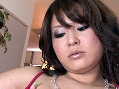 Flamboyant Japanese harlow in outright pinkish lingerie rubs her bearded pussy with manicured fingers before she takes a mini vibrator to tease her oversized tits and bearded vagina.