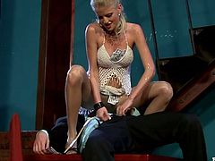 Sugar daddy picks a jaw dropping blond stripper to perform a private dance for him. She dances seductively in front of him receiving big pieces of money in her bra and panties.