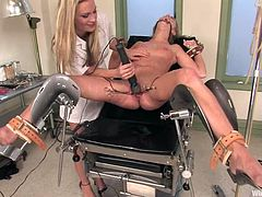 Sweet blonde girl lies in gynecology chair and gets tied up by Harmony. After that Jaelyn gets her tight pussy toyed deep.