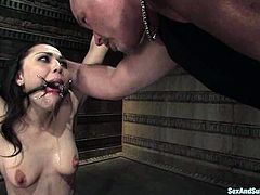 This super sassy brunette sex slave gets a cock after some abuse and humiliation. She loves it in pain, but sucking a cock is something that she loves better.