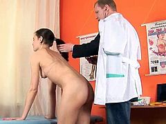 This nasty gyno doctor's hands keep wandering and finding themselves all over a shy brunette patient and even slip between her legs during this strange European exam.