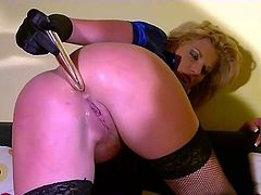 Booty blondie wears strapon and uses dildos to drill the holes of nasty gal