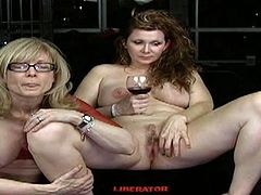 Mature blonde along young beauty are having pleasure masturbating oen another