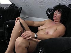 brunette mature slut in stockings is making some dirty work here. She is totally undressed and showing her huge boobs and fragile body. She is so horny that she spreads her legs and keep rubbing it until her vagina is fully wet. Then she is licking that love juice with both of her hands. Watch!