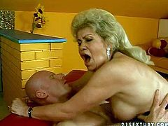 Mature blonde whore Effie with big fake tits and bouncing ass in stockings and corset has lusty sixty nine with young bald stud and rices on his stiff pecker to orgasm