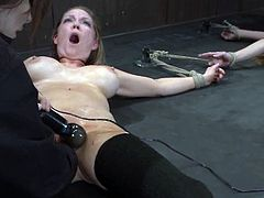 Two blondes with big boobs are tied up to the floor for a toying session courtesy of Isis Love, the kinkiest bitch alive.
