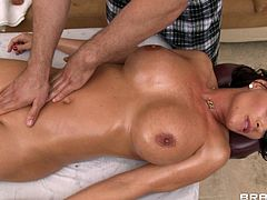 Hottie with big tits enjoys hunk giving her more than just massage after getting her naked