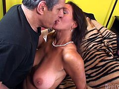Fuckable brunette mature hooks up with a gray-haired daddy. She welcomes a face sitting from him before he pokes her hairy pussy in missionary style.
