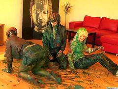 Gosh, these bitches are surely mad. Spoiled nymphos are ready to fight and the loser will get her twat tickled rough. Three dirty whores are covered with green paint. All sweaty slim bitches fight furiously on the floor, spin, cream, grab necks, pull hair and jam tits severely.
