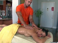 Arousing brunette pornstar Rachel Roxxx with hot ass and nice hooters gets her body covered with oil and massaged good by dirty masseur with hog body in living room