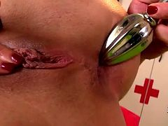 Fuckable red-haired slut drills her asshole with sleek metal plug