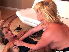Voluptuous moms please one another on a couch having passionate lesbian sex. As they are skilled porn performers they show outstanding scene.