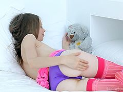 Beautiful Gloria is a big girl now so she leaves her teddy bear to play with her pussy. The milky white chick loves to taunt us so she plays with those panties and then takes them off. Look at her fragile body and those sexy thighs, wanna see what's between them? Stick with her and have some fun!