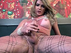 Ana Beatriz opens her corset to expose the sexy tanlines on her nice boobs. She bends over and shows off her nice ass. You want to reach out and grab her ass. She leans back and strokes her big thick cock in your face.