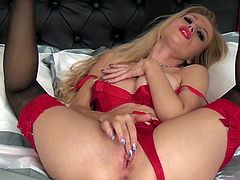 Michelle Moist is a gorgeously beautiful blonde in tempting red lingerie. She shows off her sexy body on the bed and touches her pink snatch over and over again. Watch lady in red pose and play with herself.