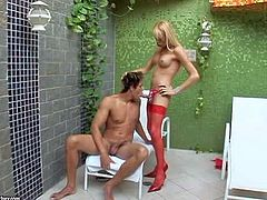 White-haired shemale Shakira Maya with long legs and round tits gets her asshole filled with hard dick of her fuck buddy. Watch transsexual blonde in red stockings get anally used by hot guy.