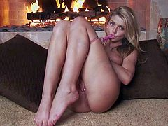 Staci Silverstone is a teen cutie that touches her sexy boobs before she takes off her tiny pink panties. Then she spreads her slim legs and touches her snatch. Watch her play with herself by the fireplace.