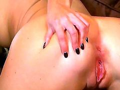 Niki Young with hairless bush gives herself some muff pie stimulation with the help of her fingers