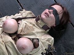 Tied up and in a straitjacket the whore can't do nothing but accept her fate. She's being hanged upside down and a black executor drills her throat with his massive dick. The bitch can't even beg for mercy as the dude continues to fuck her mouth merciless. That's what she deserve for being a naughty slut