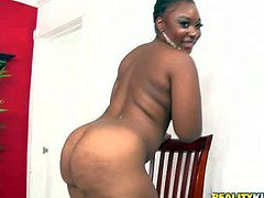 Curvy ebony slut La Reina with phat ass and nice natural jugs takes off her thong panties and then gets her meaty pussy drilled by white cock doggystyle. Watch big ass chocolate honey get shagged.