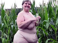 Redneck whore Tina is one of those bbw with a lot of lust. She's in the corn field and starts acting naughty. Her big, fat pussy needs some fucking and because there's nobody around Tina grabs a corn and fills her vagina. The fucking whore needs more then that, let's see if she will get some hard cock
