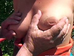 Kinky weird nympho Veronika G provides old man with a blowjob outdoors