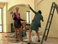 Kinky bitches catch their colleague fucking worker in an empty house. When they are left alone in the room they go messy with glue.