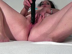 Her lustful eyes tell us everything about how horny she is right now. Look how this bitch is sucking her huge dildo and trying to lick some love juice from that after pushing it in her pussy. She still keeps rubbing and fingering her fragile pussy and as well keeping her viewers entertained.