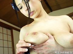 Japanese chick in traditional dress makes hot solo show. She massages and licks her tits. After that she also stuffs her vagina with a vibrator.