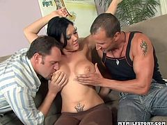 Superb brunette milf with big tits enjoys two guys fucking her brains out in threesome