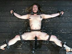The busty beauty Lindsey Grant is getting toyed for an orgasm as she's bounded in this bondage porn video.