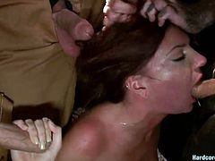Exploring this cave made the guys go primitive and hottie Cassandra found out how wild they can get. They've knelt her and roughly fucked her pretty mouth before taking care of that hot ass. Cassandra had no chance of escaping so she obeyed and even started to like the brutal cave gang bang fuck